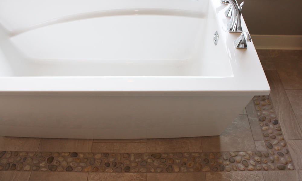 Free-Standing Tub with Inset Pebble Border