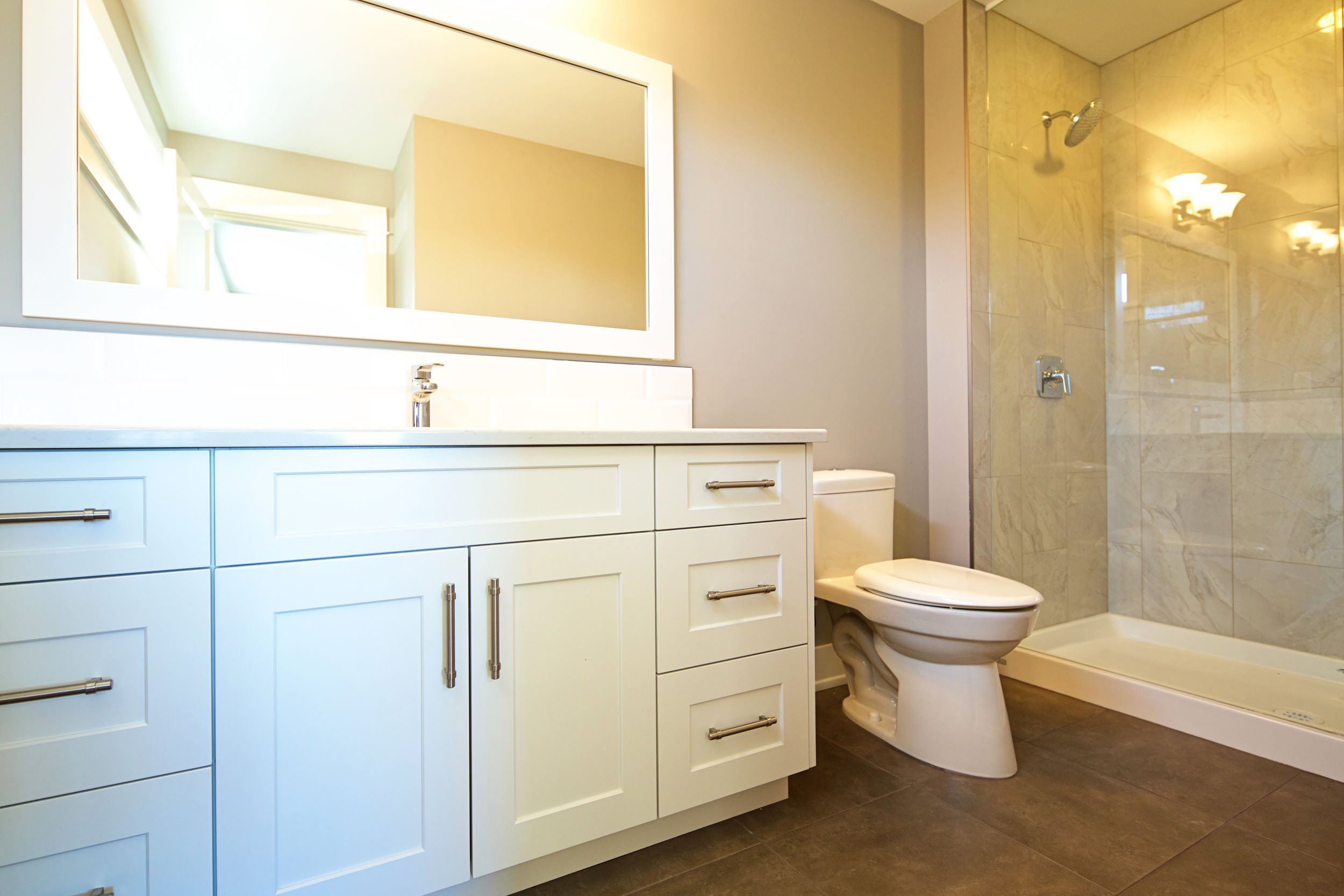 Guest Bathroom with White Cabinetry